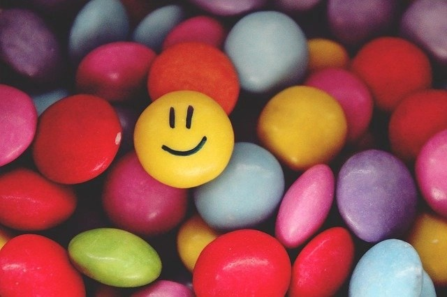 Smiley face candy representing happiness, one of the best productiity tips