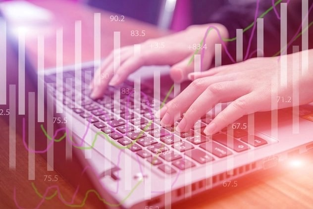 Woman working on keyboard to find how how much can I earn as a scopist