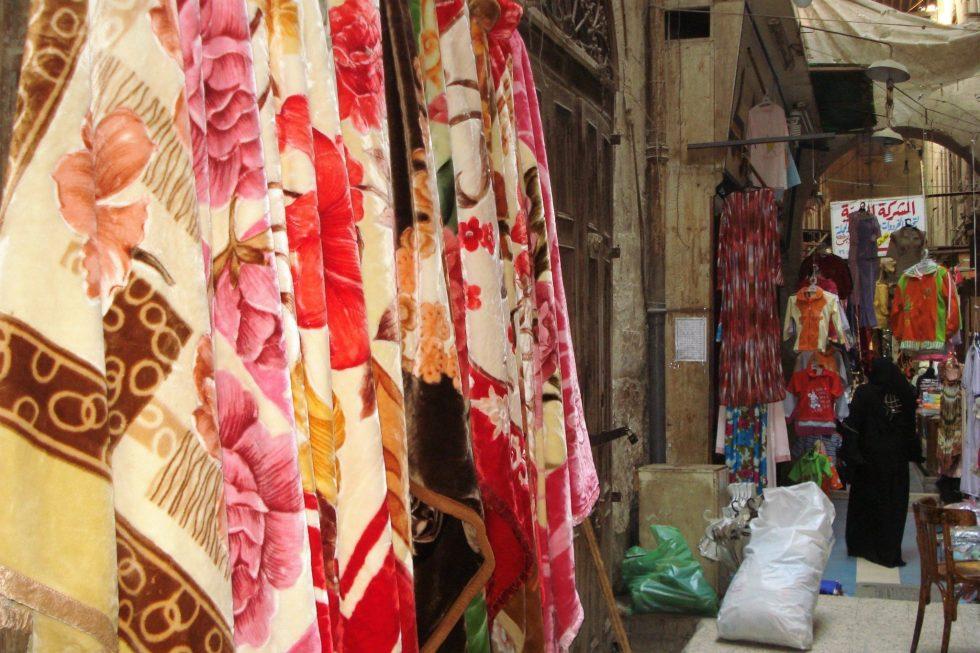 Colourful blankets hanging in Khan el Khalili souq in Egypt