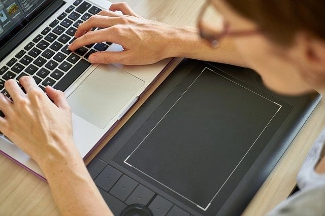 Woman scopist working on her laptop