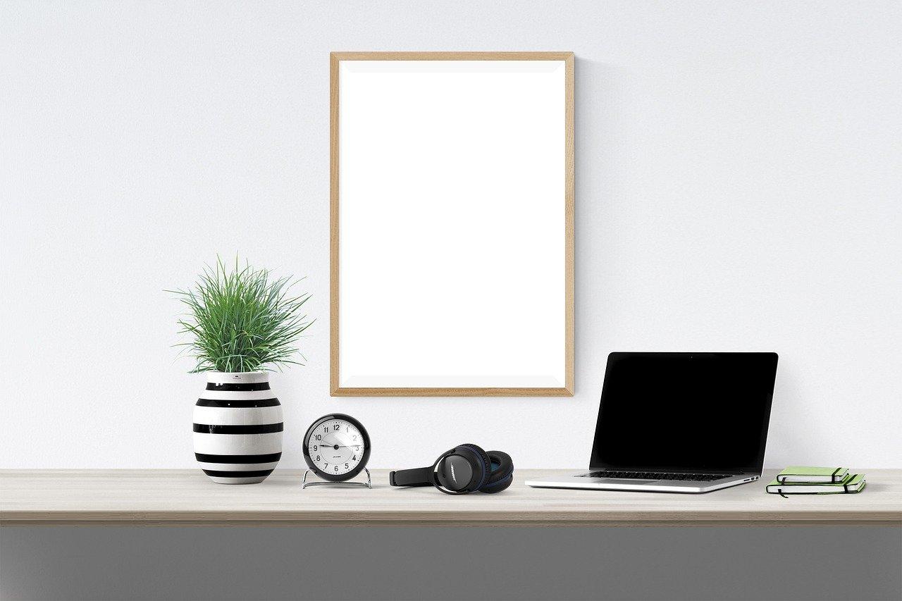 Computer, Transcription Headphones, Clock And Vase On Desk