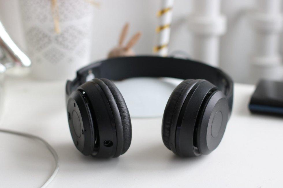 Black padded over-ear headphones for legal transcription