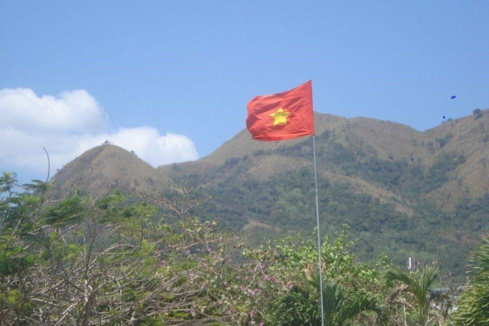 Vietnam flag with hills behind it in Nha Trang, Vietnam