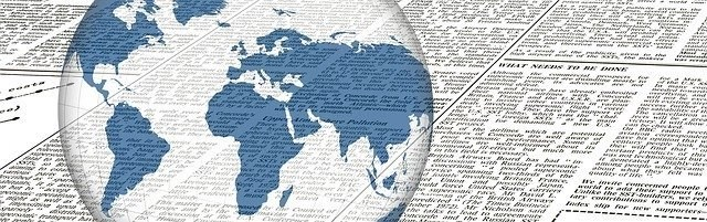 White Earth With Blue Countries Superimposed On A Black And White Newspaper Representing World Freelance News