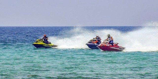 Three jetskis on the water, rented out to make passive income