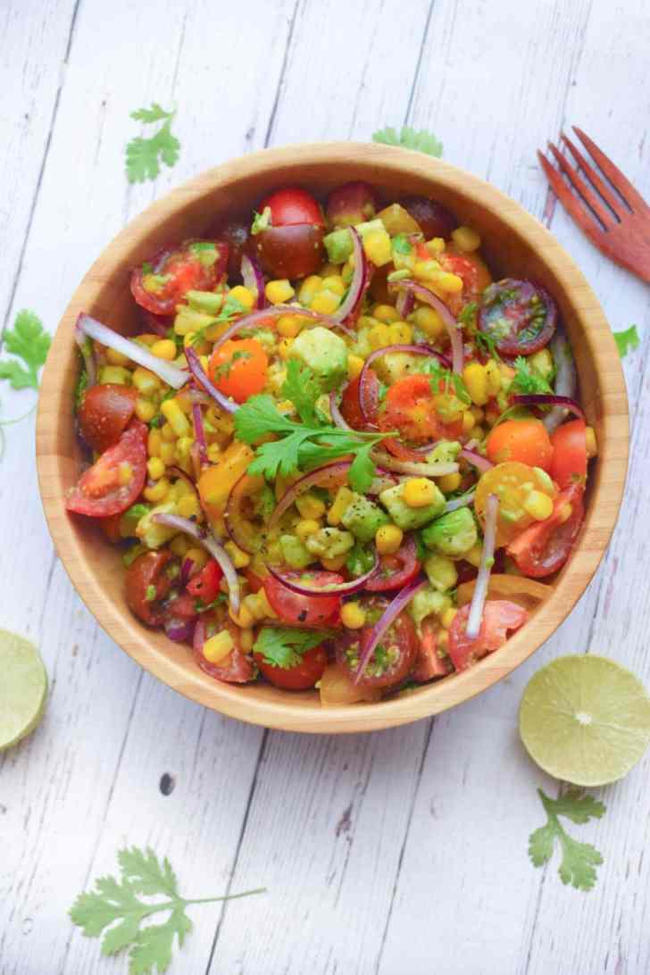 Fresh Summer Tomato Salad Recipe   Easy Vegan Side   World of Vegan   #summer #salad #tomato #avocado #fresh #worldofvegan