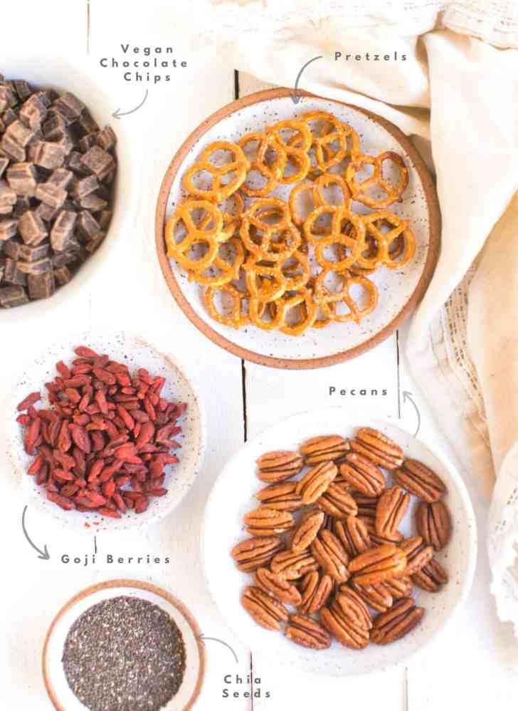 Vegan Chocolate Bark Ingredients—Goji Berries, Chia Seeds, Pecans, Chocolate Chip, Pretzels