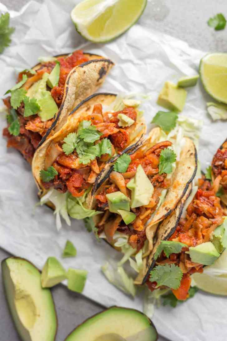 Vegan Mushroom Tacos With Avocado and Lemon Wedges
