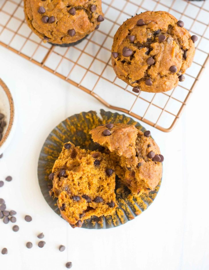 Vegan Pumpkin Muffin Openen on a Cupcake Wrapper by the cooling rack