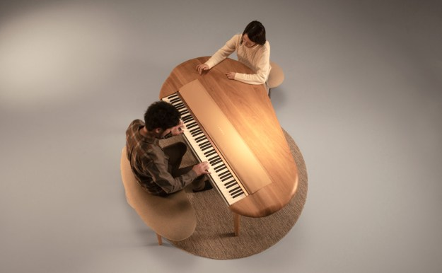 """Yamaha's A-Round concept piano from above with pianist and """"listener"""""""