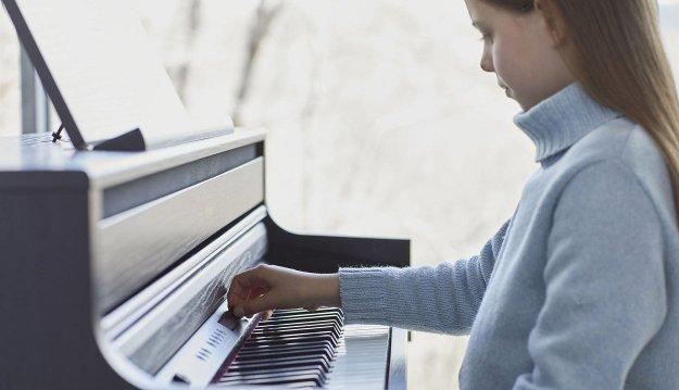 Girl playing HP704 at home