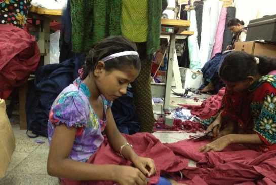 Girls working in clothing factory