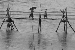 monks crossing the bridge