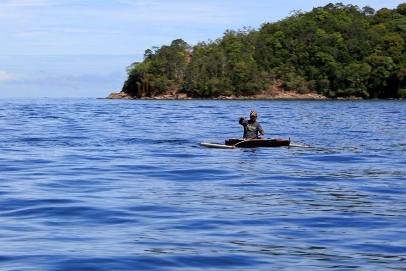 Fisherman off Pulau Sapi, Tunku Abdul Rahman Park, Malaysia