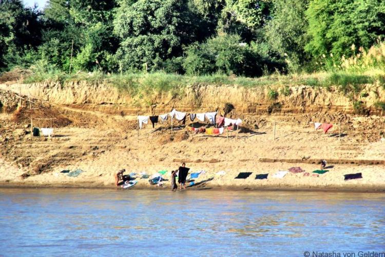 Riverside life Mandalay to Bagan boat Myanmar