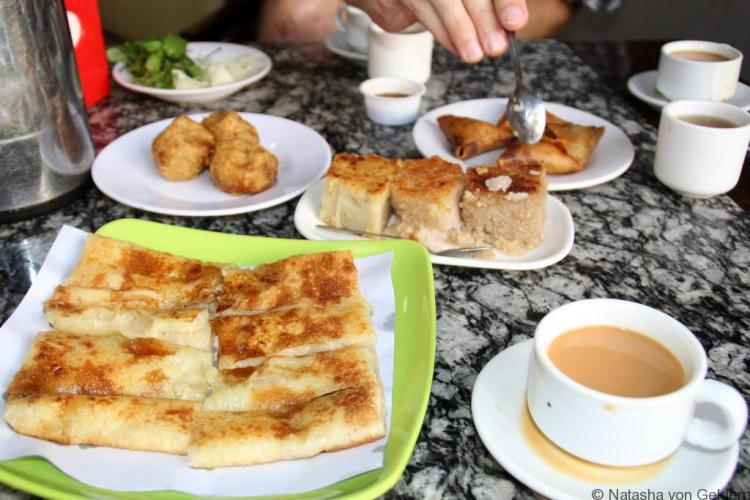 Snacks at a Mandalay tea shop on the foodies tour Myanmar