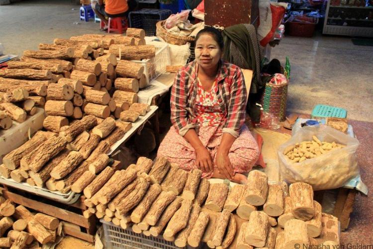 Thanaka maker in Mandalay market Myanmar