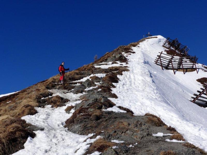 Ski Alpbach climbing the Wiederberg summit Tirol Austria