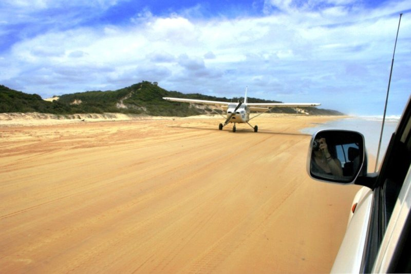 Scenic flight Fraser Island landing on 75-mile beach Australia