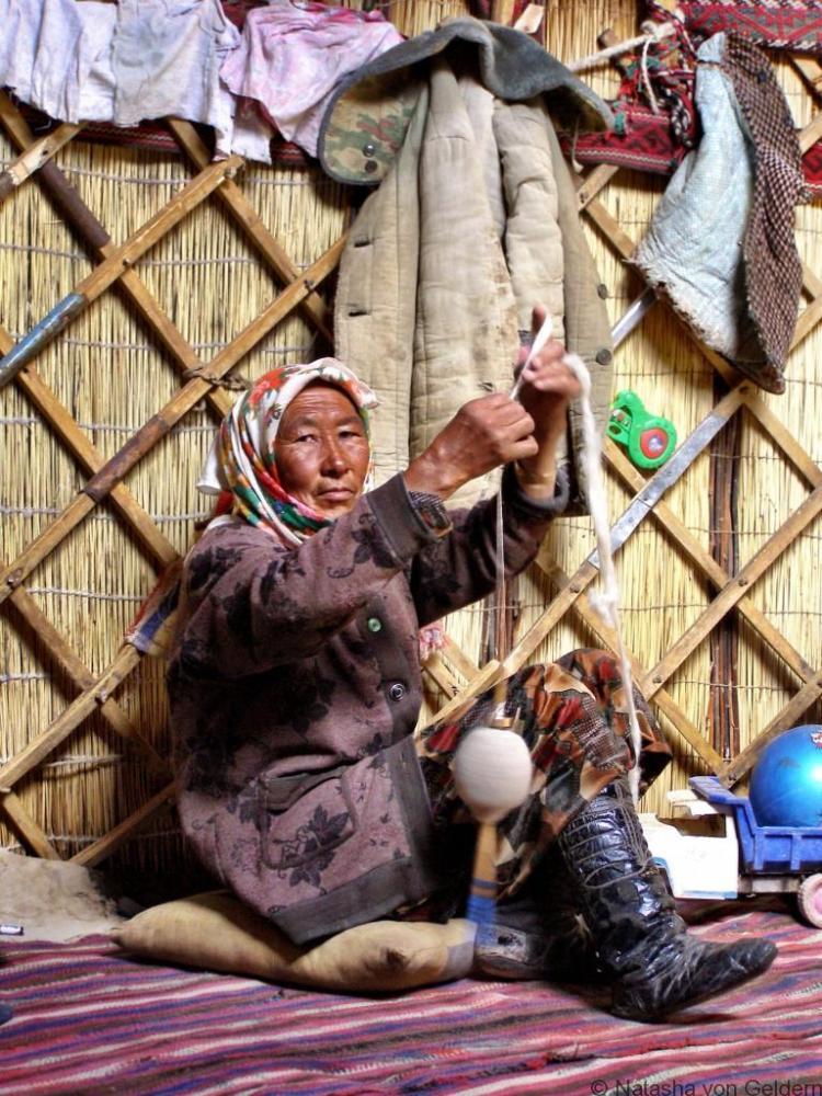 Kyrgyz woman spinning in a yurt Tajikistan GBAO Pamir travel