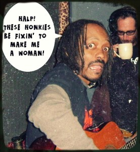 """Bishop Calvin Cumming IV, lead singer for Formerly Known As, A Tribute to Prince saying """"Halp! These honkies be fixinin' to make me a woman!"""" with a scared look on his face."""