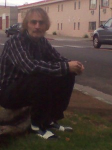Dale Kellams sitting on a curb