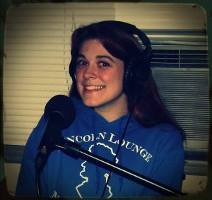 Kelly Ogilvie on the Worst Little Podcast wearing a blue Lincoln Lounge sweatshirt at Dogwater Studios