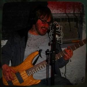 Matt Kaminsky playing bass on the Worst Little Podcast