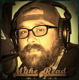 myke read in a bronzed photo