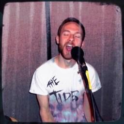 Derek Todd eating the mic