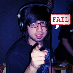 """Gabe Day with a speech bubble saying 'Fail"""" and pointoing at the camera"""