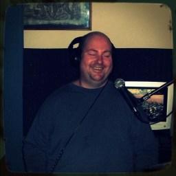 Milton Bradshaw smiling greatly.