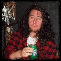 Spencer Kilpatrick, guitar and vocals for Failure Machine, with a beer looking sad and haggard