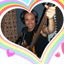 Eric Marks, smiling big, with an illustrated rainbow heart drawn around the image.