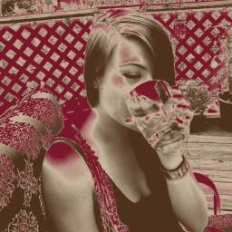 Raina, drinking whiskey.