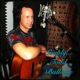 "Todd Ballowe, sitting with guitar, with the text ""Simply... todd ballowe"" in a fancy script"