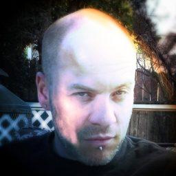 Rick Baker, closeup of his bald head, heavily photoshopped