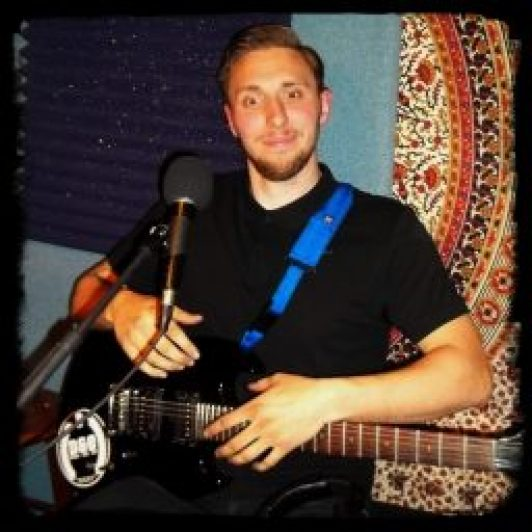 Nathan Koop of Reno Nevada band Down and Out at Dogwater Studio hamming it up for the camera.