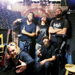Reno metal band Qarin posing and laughing for the camera at the studio recording the Worst Little Podcast.