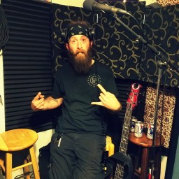 Yo-yo, bassist and vocalist for Reno metal band Qarin posing for the camera while recording for the Worst Little Podcast.