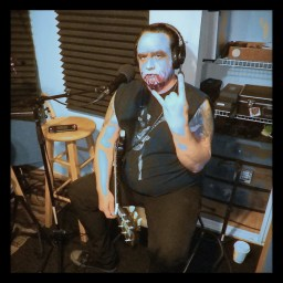Franky Ferox posing for the camera at Dogwater Studios.