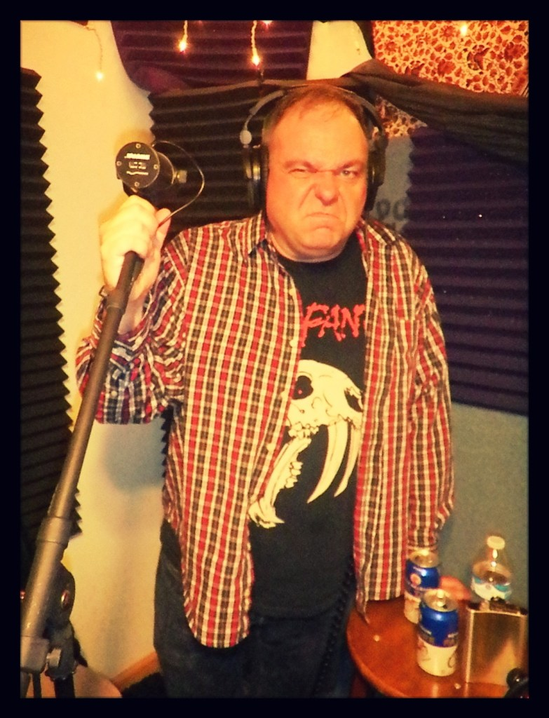 "Mark ""the Adorable Hulk"" sneering into the camera while recording for the Worst Little Podcast at Dogwater Studios."