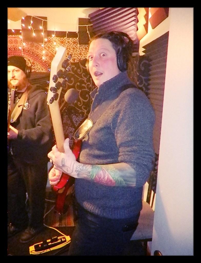 Tony, guitarist for Reno metal band Kanawha posing with his guitar at Dogwater Studios.