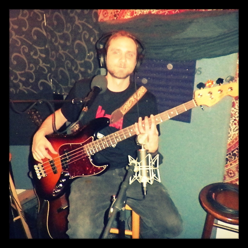 Kevin from Reno band Blacklisted posing with his bass at Dogwater Studio recording for the Worst Little Podcast.