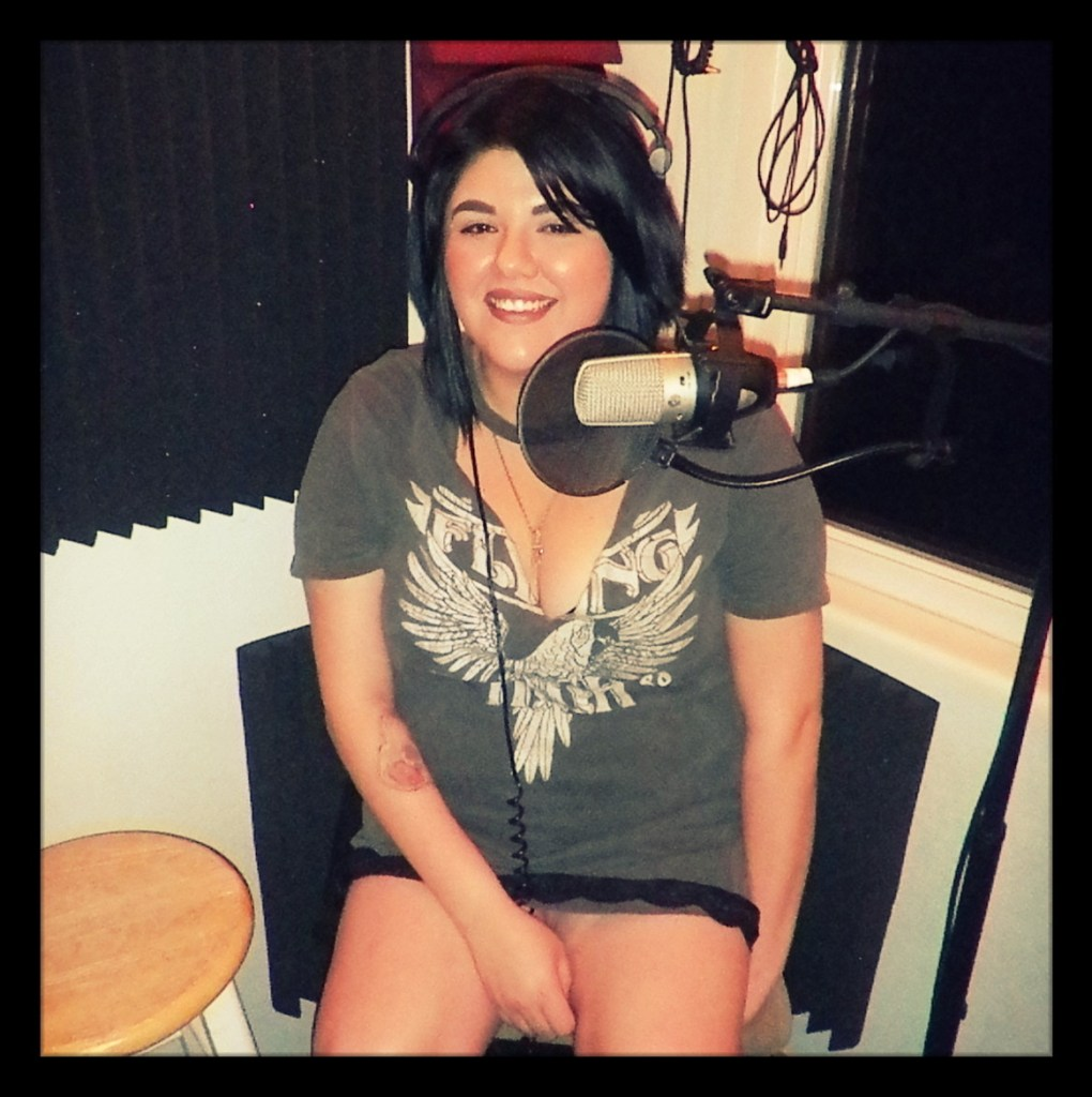 Tori from Blacklisted posing in the studio recording for the Worst Little Podcast.