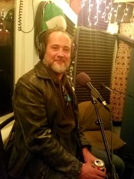 Remi Jourdan founder of tune trax in Reno nevada talking into the microphone while recording the worst little podcast.