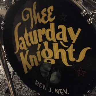 THee saturday kinights logo on the kick drum