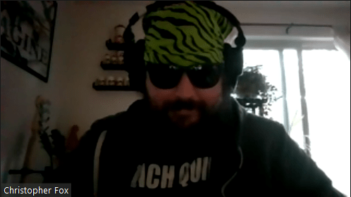 Chris FOx wearing a green tiger-striped bandanna and sunglasses, like Randy Savage