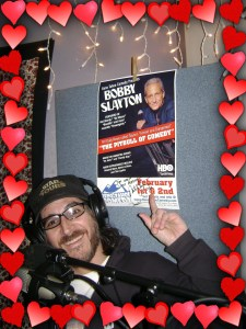 Nick Ramirez posing with autographed poster of Bobby SLayton
