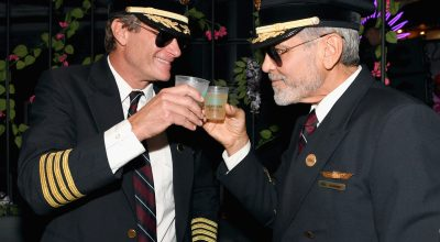 Rande Gerber (L) and George Clooney (R) toast the success of their Casamigos tequila brand which sold to British beverage company Diageo in 2016 for $1 billion.